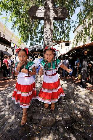 Four year old twins Jazmin (L) and  Sarah Chavez from San Bernardino, California attend Cinco de Mayo festivities on May 5, 2010, at El Pueblo de Los Angeles Historic Site on Olvera Street in downtown Los Angeles, California. Photo: ., Getty Images