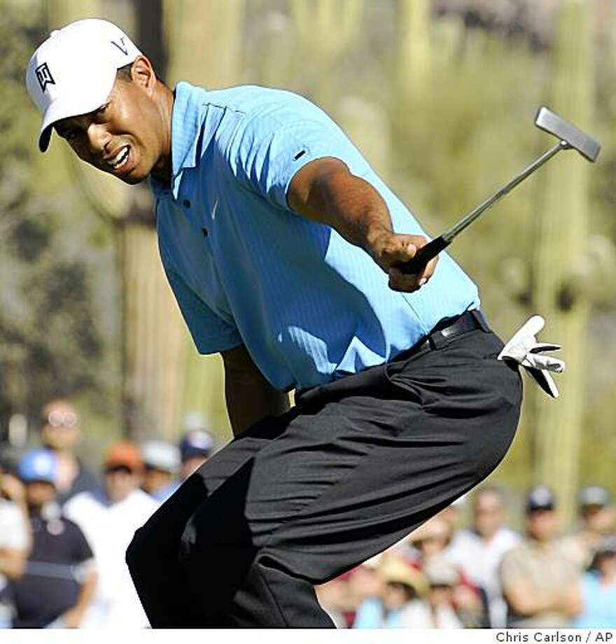 Tiger Woods reacts to just missing a birdie putt on the 11th hole during the first round of the Accenture Match Play Championship golf tournament Wednesday, Feb. 25, 2009, in Marana, Ariz. Photo: Chris Carlson, AP