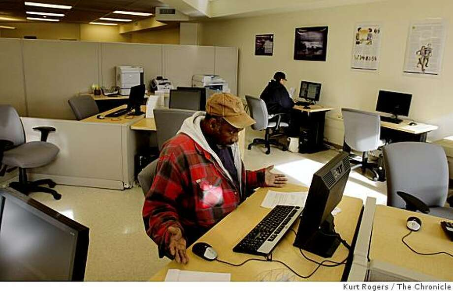 Anthony Wells sits at the new One-Stop Career Link Center in the Western Addition and uses the self-directed area of the help center to look for a job on Wednesday, Feb. 25, 2009 in San Francisco, Calif. Photo: Kurt Rogers, The Chronicle