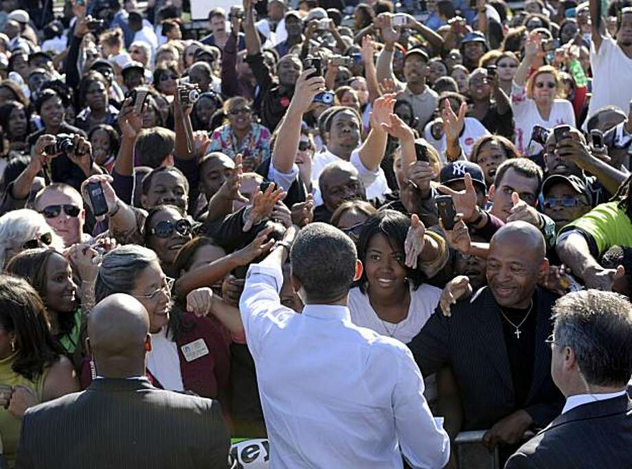 FILE - In this Oct. 7, 2010, file photo, President Barack Obama greets people after speaking at a campaign rally for Maryland Gov. Martin O'Malley at Bowie State University in Bowie, Md. Despite polls indicating many minority voters are discouraged and won't turn out Nov. 2 like they did for Obama two years ago, a solid showing among blacks could still swing several House, Senate and gubernatorial races, according to some analysts. Photo: Susan Walsh, AP