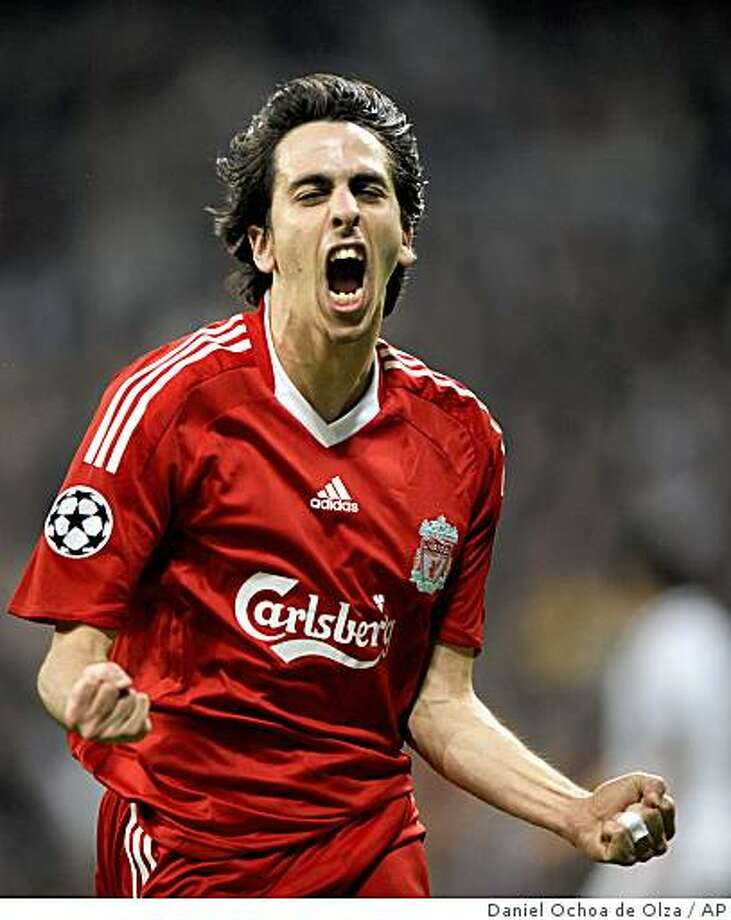Liverpool's Yossi Benayoun from Israel celebrates after scoring a goal against Real Madrid during his Champions League, Round of 16, first leg soccer match at the Santiago Bernabeu stadium in Madrid on Wednesday, Feb. 25, 2009. Photo: Daniel Ochoa De Olza, AP