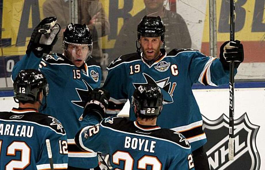 San Jose Sharks' Joe Thornton celebrates scoring a goal with teammates Dany Heatley (15) Patrick Marleau and Dan Boyle (22), during the third period of a NHL hockey game against Columbus Blue Jackets, in Stockholm, Sweden, Saturday, Oct. 9, 2010. Photo: Niklas Larsson, AP