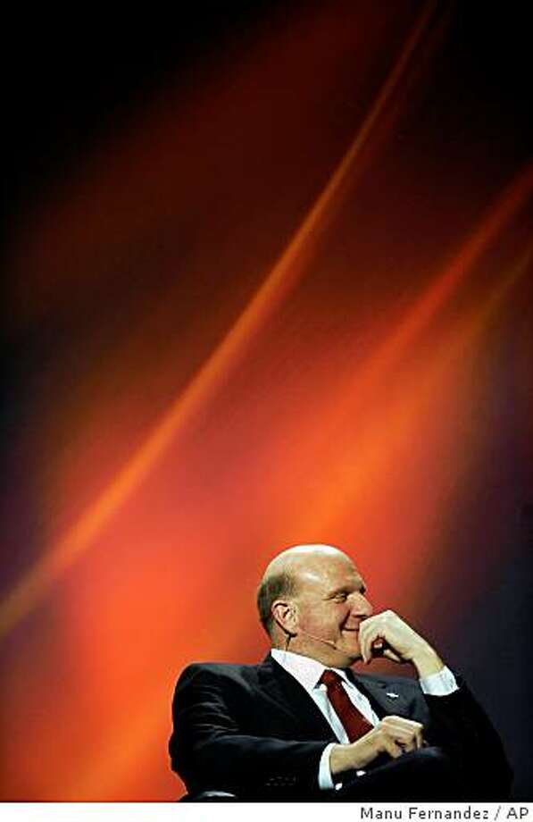 Microsoft CEO Steve Ballmer looks on during a conference at the Mobile World Congress in Barcelona, Spain, Tuesday, Feb. 17, 2009. Some 50,000 industry officials from major cell phone makers, telecom companies and high-technology firms are converging in Barcelona for an annual four-day Mobile World Congress that opened Monday. (AP Photo/Manu Fernandez) Photo: Manu Fernandez, AP
