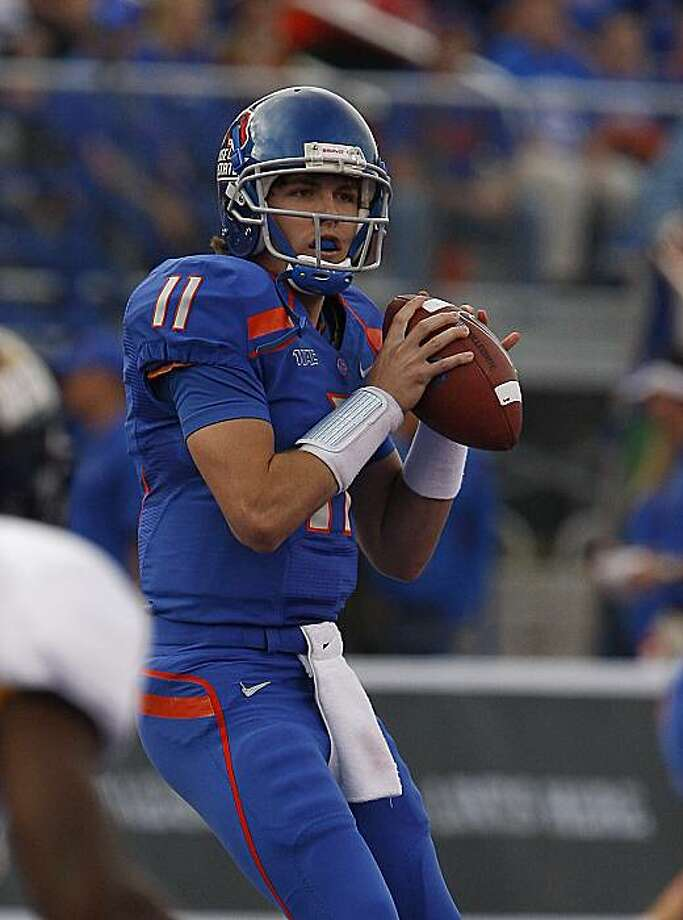 Boise State's Kellen Moore sets to throw downfield against Toledo during the first half of the NCAA college football game on Saturday, Oct. 9, 2010 in Boise, Idaho. Photo: Matt Cilley, AP