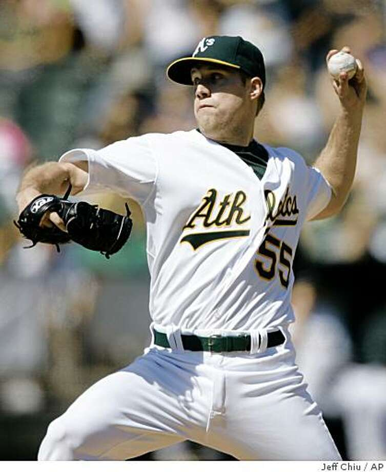 Oakland Athletics' Josh Outman pitches to the Texas Rangers in the fifth inning of a baseball game Saturday, Sept. 13, 2008, in Oakland, Calif. (AP Photo/Jeff Chiu) Photo: Jeff Chiu, AP