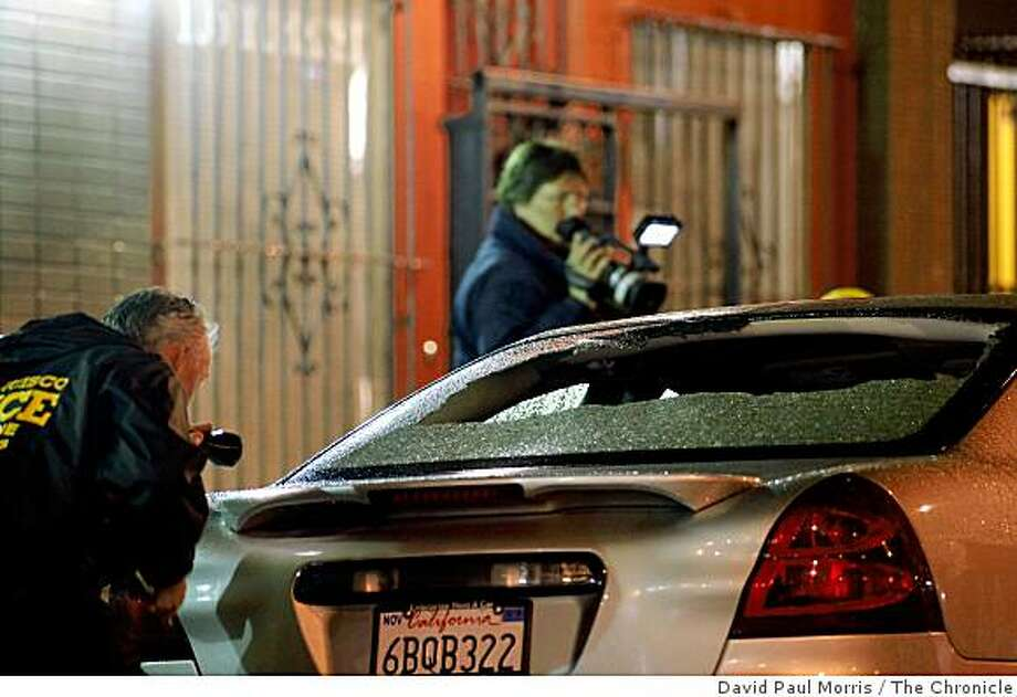 San Francisco Police investigate a shooting which killed 1 person and left 4 others injured on Turk Street near Taylor Street in the Tenderloin district on February 23, 2009 in San Francisco, Calif. Photo: David Paul Morris, The Chronicle