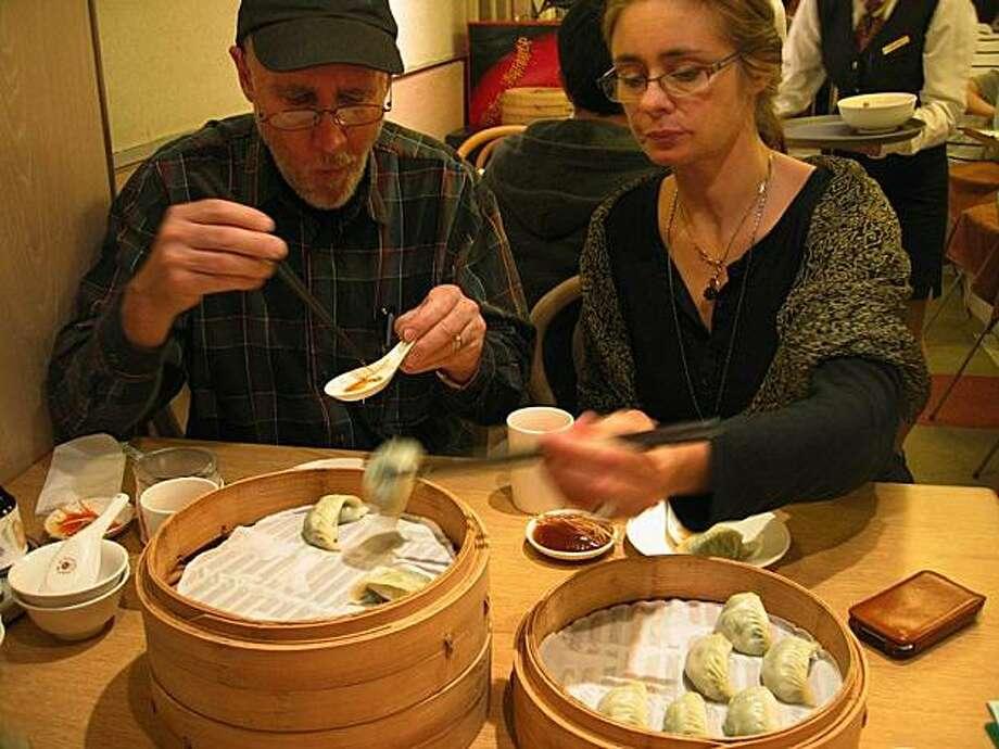 Peter Menzel and Faith D'Aluisio eating dumplings in a Taiwan restaurant in Taipei Photo: Josh D'Aluisio