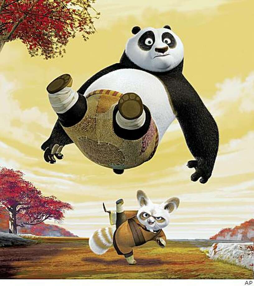 "In this image released by DreamWorks Animation, giant panda Po, voiced by Jack Black, begins his study under Master Shifu, below, voiced by Dustin Hoffman in a scene from DreamWorks' ""Kung Fu Panda."" DreamWorks Animation SKG Inc. on Tuesday, Feb. 24, 2009 said that its fourth-quarter profit fell as revenue sank 31 percent. The company said ""Kung Fu Panda"" added $101.8 million to its fourth-quarter revenue, mostly in DVD sales. (AP Photo/DreamWorks Animation) ** NO SALES ** Photo: AP"