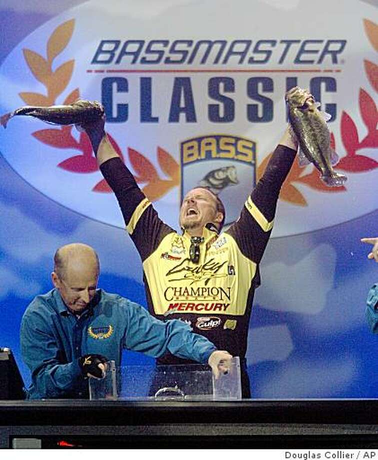 Skeet Reese holds up a pair of fish after taking the lead during the final day of competition of the Bassmaster Classic fishing tournament on Sunday, Feb. 22, 2009 in Bossier City. (AP Photo/The ( Shreveport ) Times, Douglas Collier) ** NO MAGS, NO SALES, MANDATORY CREDIT ** Photo: Douglas Collier, AP