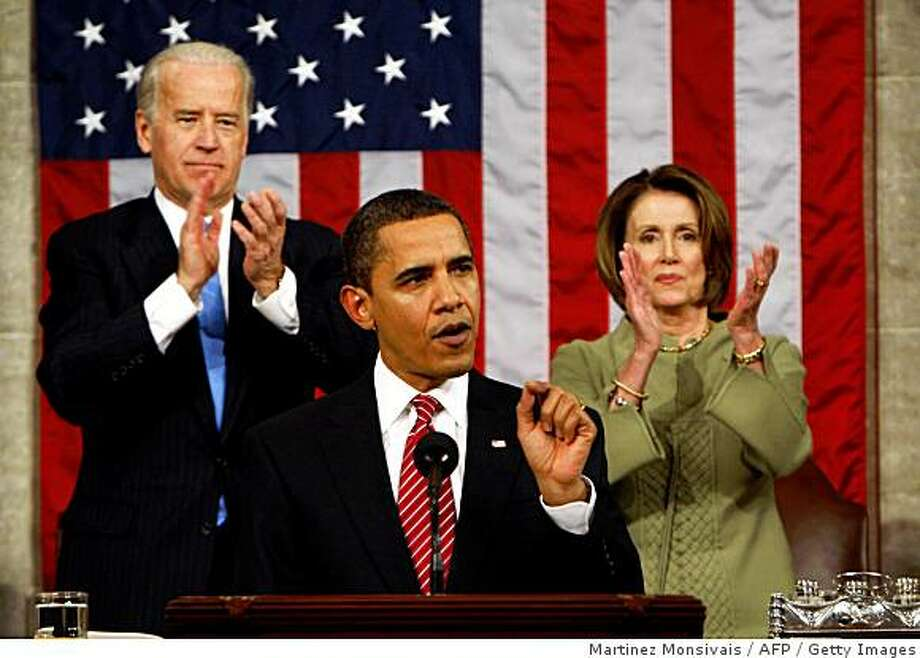 Vice President Joe Biden and House Speaker Nancy Pelosi of California applaud as President Barack Obama addresses a joint session of Congress in the House Chamber of the Capitol in Washingtona on February 24, 2009. Photo: Martinez Monsivais, AFP / Getty Images