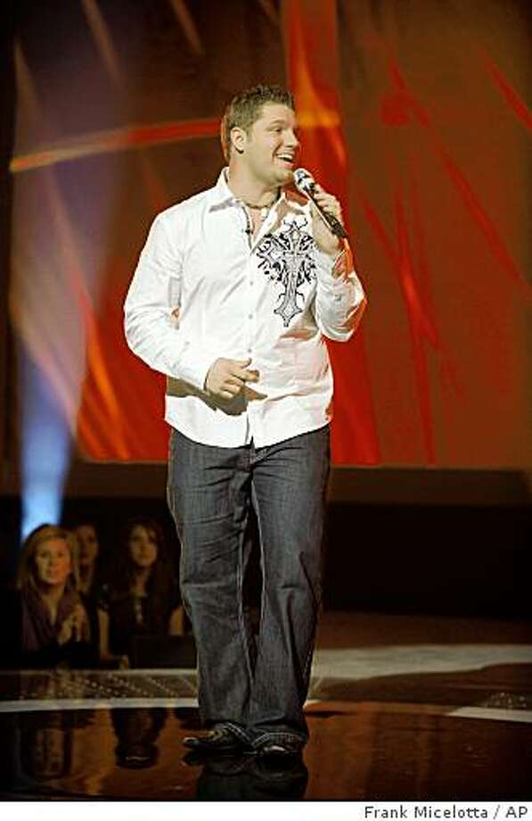 """In this photo released by FOX, contestant Michael Sarver, 27, an oil rig worker from Jasper, Texas, performs in front of the judges on"""" American Idol"""" , Tuesday, Feb, 17, 2009 in Los Angeles. Photo: Frank Micelotta, AP"""