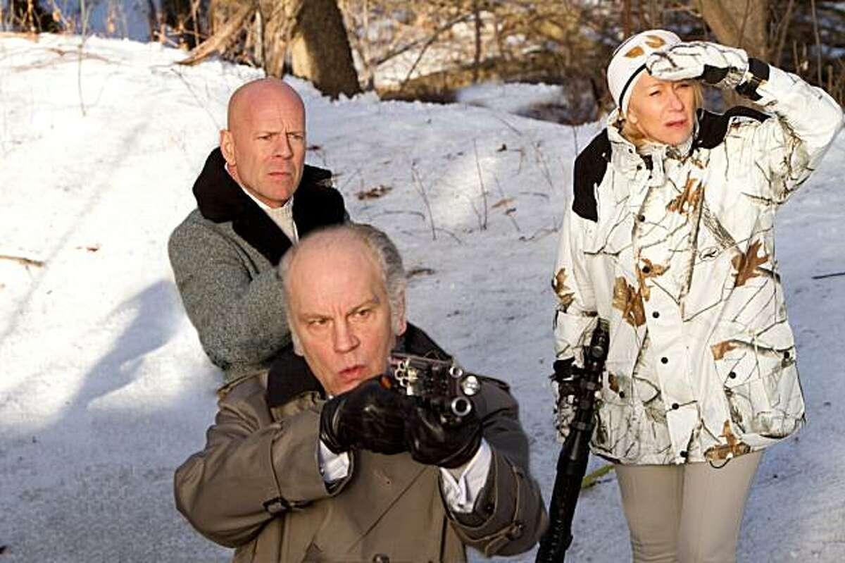 (L to R) BRUCE WILLIS, JOHN MALKOVICH and HELEN MIRREN star in RED.