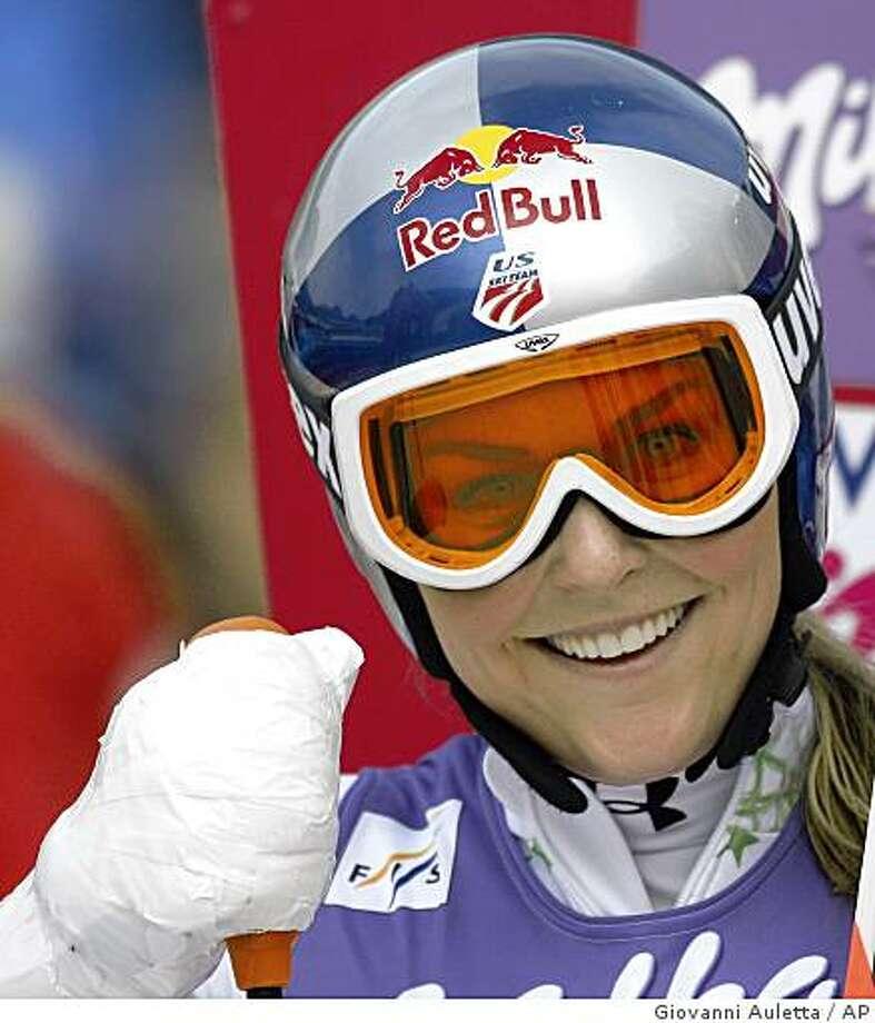 Lindsey Vonn smiles after winning an alpine ski, women's World Cup super-G race, in Tarvisio, Italy, Sunday, Feb. 22, 2009. Photo: Giovanni Auletta, AP