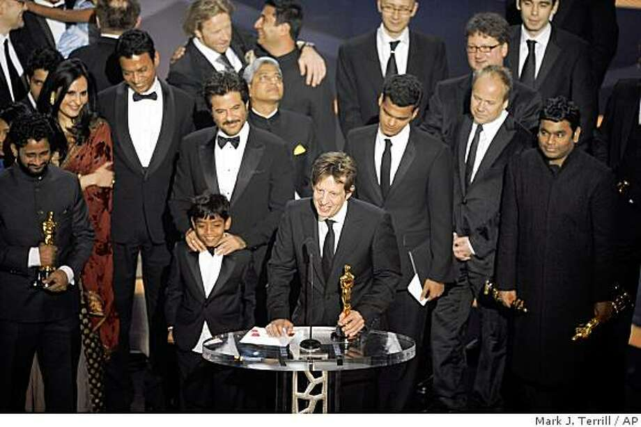 "Producer Christian Colson, along with the cast and crew, accept the Oscar after the film ""Slumdog Millionaire"" won best motion picture of the year during the 81st Academy Awards Sunday, Feb. 22, 2009, in the Hollywood section of Los Angeles. (AP Photo/Mark J. Terrill) Photo: Mark J. Terrill, AP"