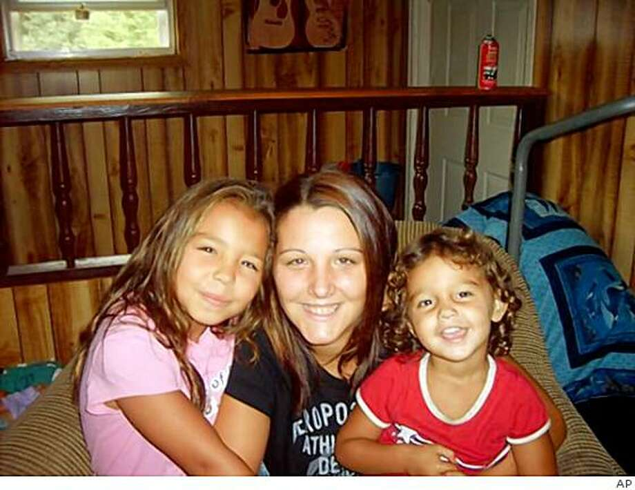 In this undated photo released by the Houk family, shows Kenzie Marie Houk with her daughters Jenessa, left, and Adalynn  in Wampum, Pa.. Eleven-year-old Jordan Brown is charged in the shooting death of the 26-year-old pregnant mother of two. (AP Photo/The Houk Family) Photo: AP