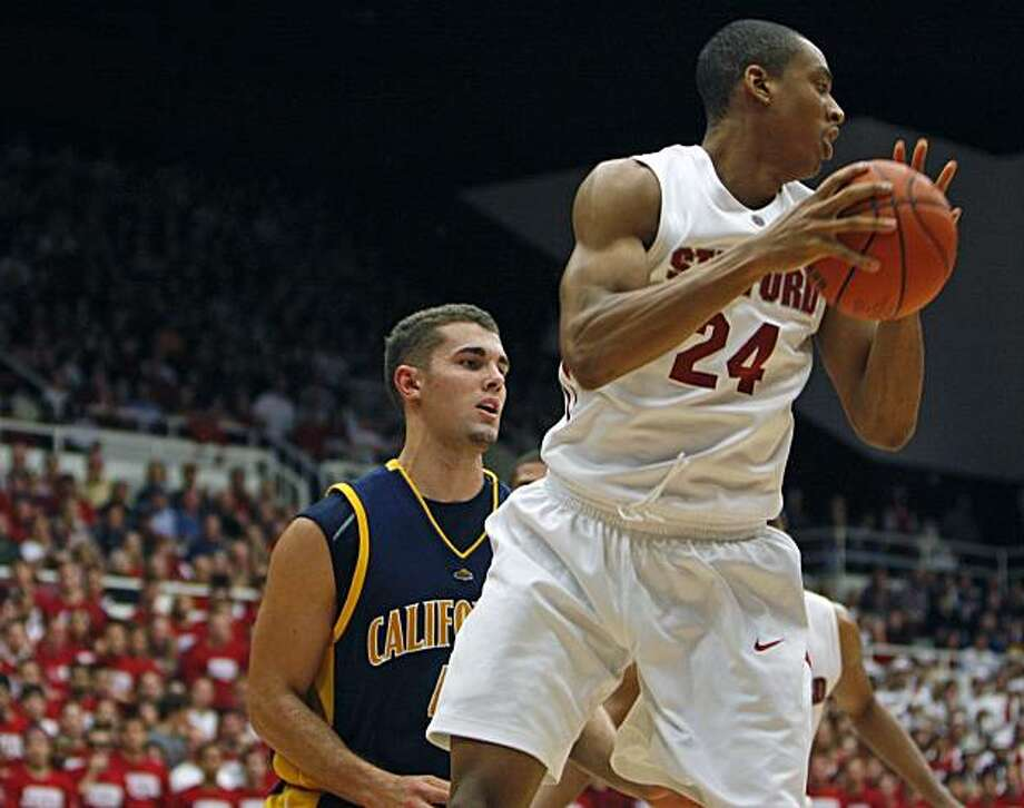 Stanford's Josh Owens hauls in a rebound in front of Cal's Harper Kamp in second period action. Stanford defeated California Saturday Jan 17, 2009 75-69 Photo: Lance Iversen, The Chronicle