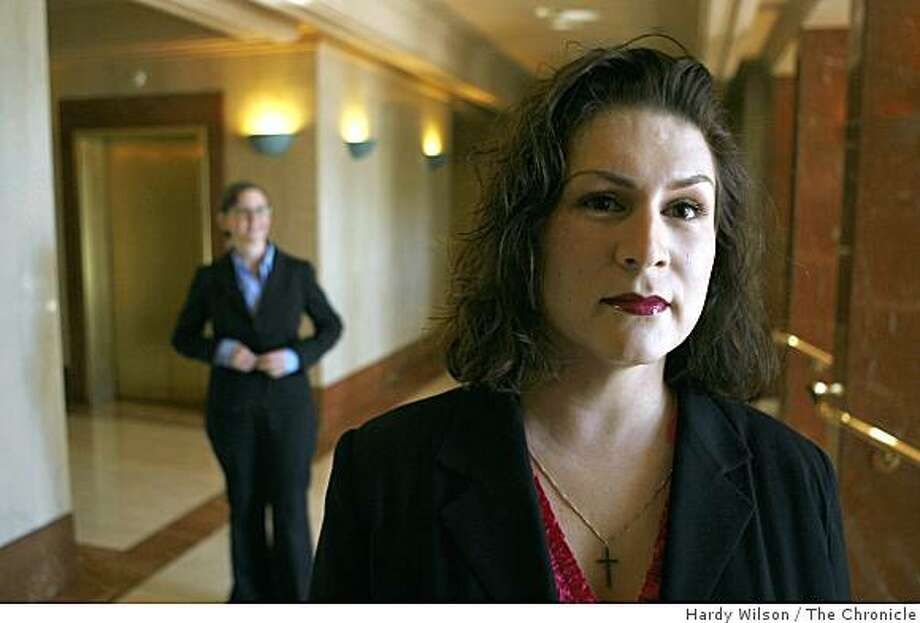 Maya Rose Perez, right, and one her attorneys Elizabeth Kristen, left, pose for a picture inside the Legal Aid Society - Employment Law Center on Tuesday, February 24, 2009, in San Francisco. Perez, a transgender employee of the Burlington Coat Factory, filed a discrimination lawsuit against the Burlington Coat Factory for the verbal and physical abuse she says she endured during and after her transition from a man to a woman. Photo: Hardy Wilson, The Chronicle