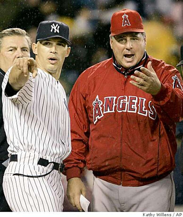 MLB manager Mike Scioscia, right, is 54. Photo: Kathy Willens, AP