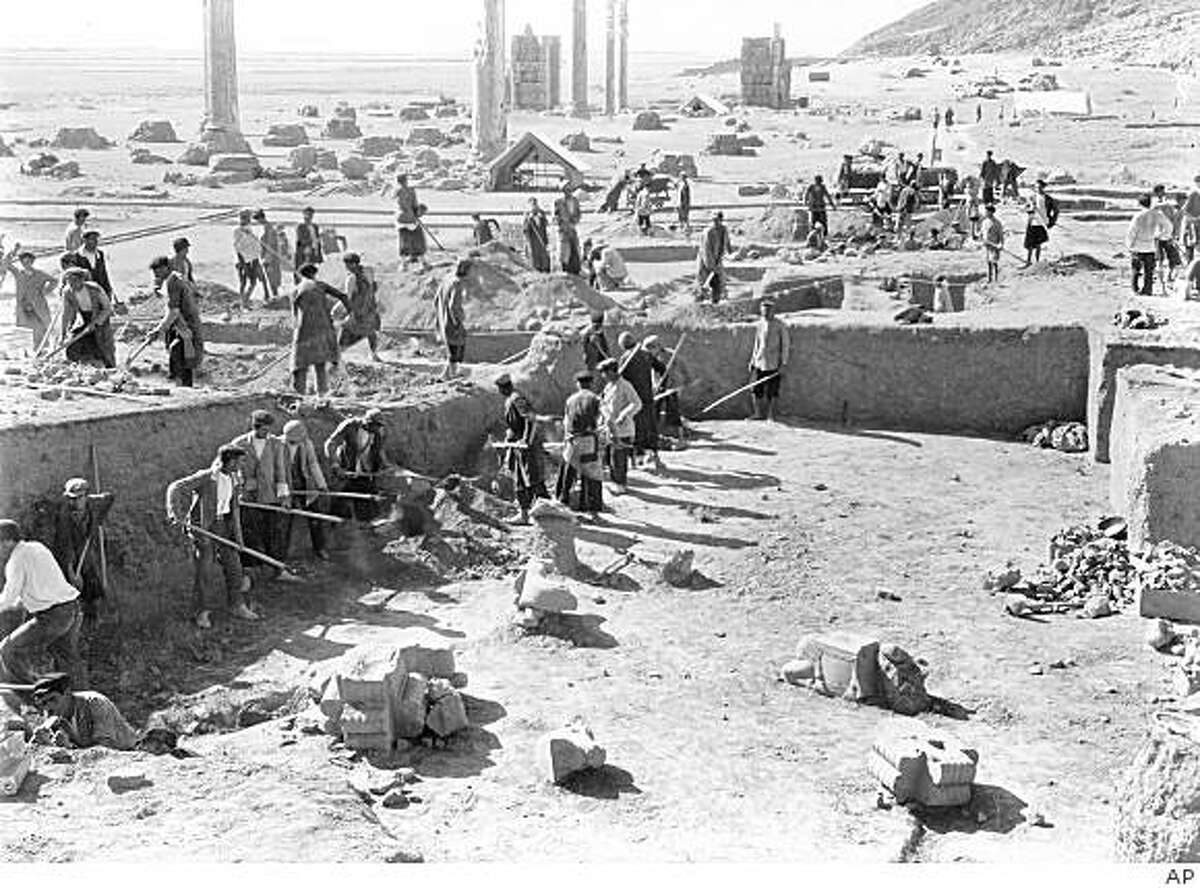**ADVANCE FOR SUNDAY, FEB. 22** A photo provided by the University of Chicago's Oriental Institute shows a scene from the 1939 excavation in Iran of the Palace of Darius, with the Apadana and the Gate of All Nations visible in the background at Persepolis, the ancient capital of the Persian empire. University scholars discovered rare tablets at the excavation site that offer a rare look at details of everyday life in what was the largest empire on earth 2,500 years ago. The tablets are the subject of an unusual lawsuit. Victims of a terrorist bombing in Israel in 1997 won a multimillion judgment against Iran and are now trying to collect by seizing the tablets and selling them. (AP Photo/University of Chicago's Oriental Institute) **NO SALES**