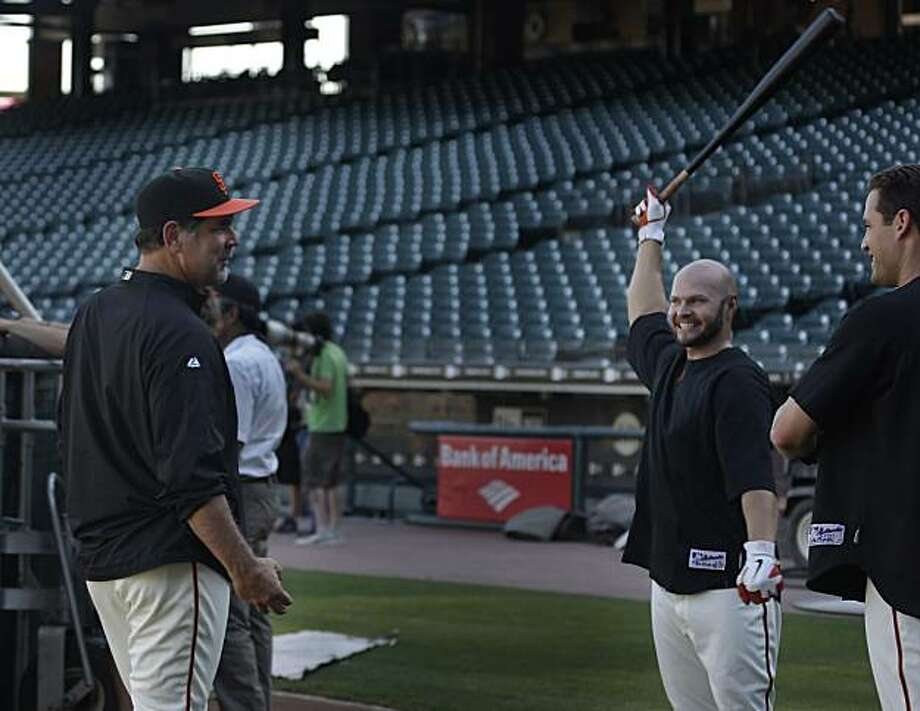 The San Francisco Giants manager Bruce Bochy (l to r) talks with right fielder Cody Ross and left fielder Pat Burrell during the Giants' workout at AT&T Park  on Wednesday, October 13, 2010 in San Francisco, Calif. Photo: Lea Suzuki, The Chronicle