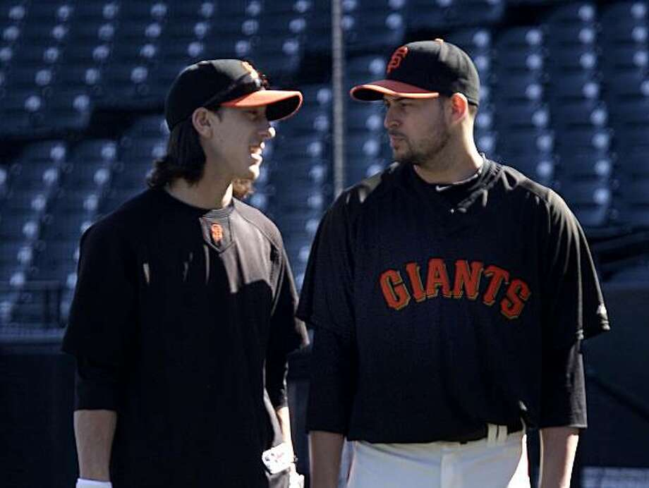 Jonathan Sanchez and Tim Lincecum chatted at first base during a workout at AT&T park Wednesday. Photo: Lea Suzuki, SFC