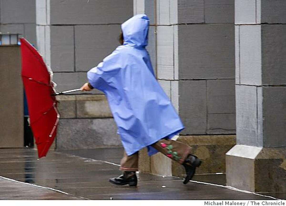An child plays in the wind and rain outside the Ferry Building in San Francisco, Calif., on Sunday, February 22, 2009. A steady wind and rain fell throughout the bay area all day,
