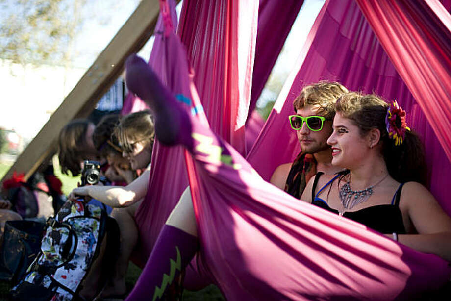 """Becca Goldberg (right) and Cosmo Goodnick sit on a series of hammocks assembled as """"participant art,"""" where participation by people is integral to the completion of the art piece at the Burning Man """"Decompression 2010"""" event in the Potrero Hill district of San Francisco on Sunday. Photo: Chad Ziemendorf, The Chronicle"""
