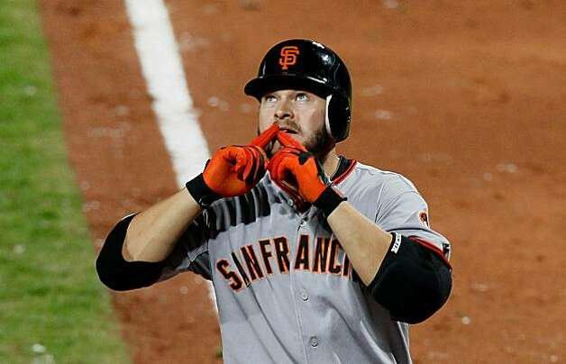 ATLANTA - OCTOBER 11:  Cody Ross #13 of the San Francisco Giants reacts after hitting a solo homer in the sixth inning against the Atlanta Braves during Game Four of the NLDS of the 2010 MLB Playoffs at Turner Field on October 11, 2010 in Atlanta, Georgia. Photo: Kevin C. Cox, Getty Images