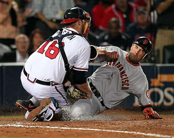 101011 Atlanta - Atlanta Braves catcher Brian McCann tags out Giants Pat Burrell trying to go home during 7th inning action in game 4 of the NLDS at Turner Field in Atlanta on Monday, Oct. 11, 2010.      Curtis Compton  ccompton@ajc.com Photo: Curtis Compton, Ccompton@ajc.com