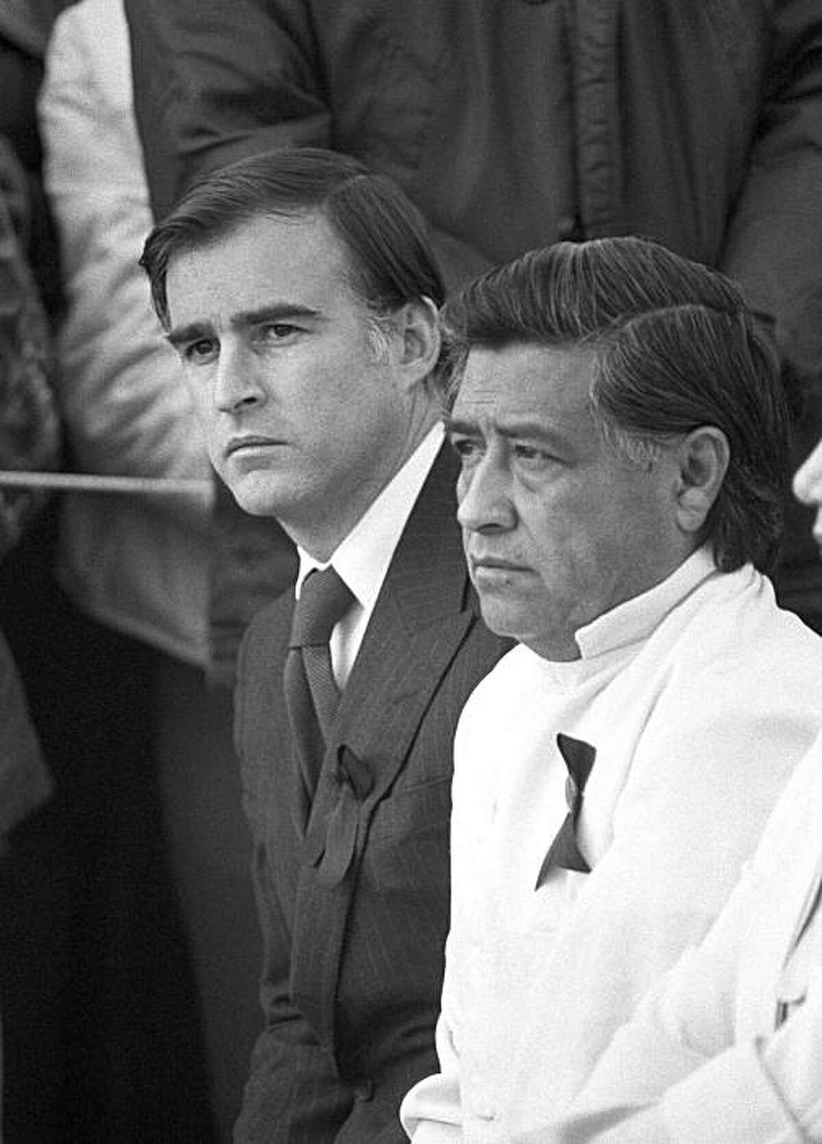 California Gov. Jerry Brown, left, and United Farm Workers President Cesar Chavez sit together during funeral Mass for slain farm worker Rufino Contreras in this California border city, Calexico, Wednesday, Feb. 14, 1979. Contreras was killed on Saturday during violence associated with the strike against Imperial County growers. Both Brown and Chavez spoke at the services. (AP Photo/Saxon)