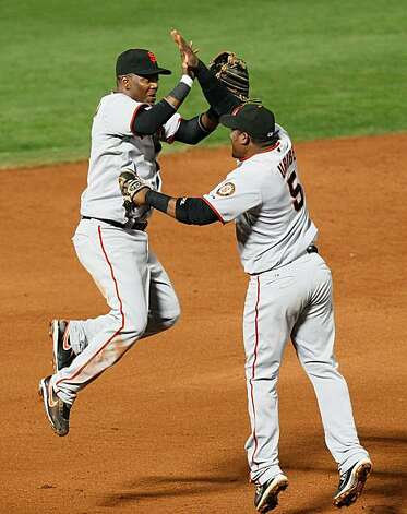 ATLANTA - OCTOBER 11:  Edgar Renteria #16 and Juan Uribe #5 of the San Francisco Giants celebrate after they defeated the Atlanta Braves 3-2 during Game Four of the NLDS of the 2010 MLB Playoffs at Turner Field on October 11, 2010 in Atlanta, Georgia. Photo: Kevin C. Cox, Getty Images