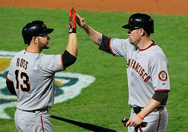 Aubrey Huff celebrates with Cody Ross after scoring in the seventh inning on a fielder's choice and an error by Alex Gonzalez of the Atlanta Braves during Game Four of the NLDS on Monday in Atlanta. Photo: Kevin C. Cox, Getty Images