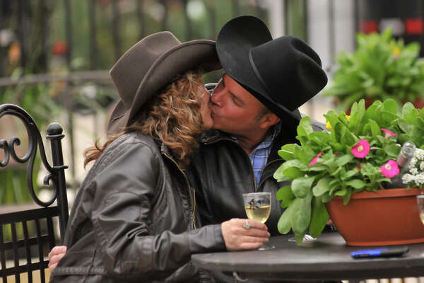 Feb. 10, 2012 -- Newlyweds Julie and Rodney Meyer share a kiss in the Wine Garden at the San Antonio Stock Show and Rodeo Feb. 9.