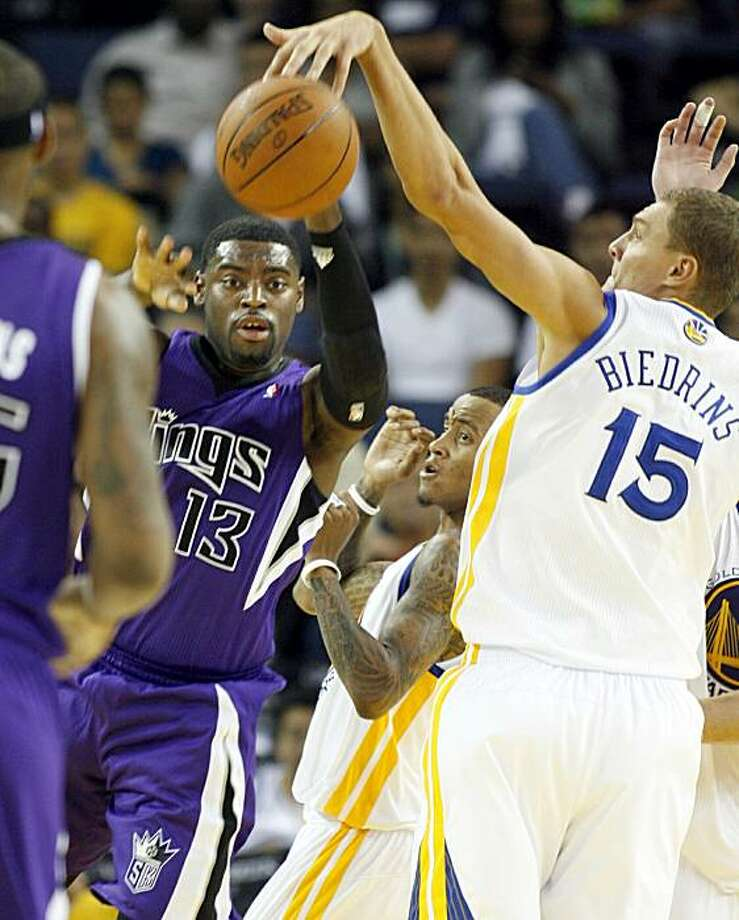 The Sacramento Kings' Tyreke Evans, left, is pressured by the Golden State Warriors' Monta Ellis and Andris Biedrins in the second half of an NBA preseason basketball game, Sunday, Oct. 10, 2010 in Oakland, Calif. Photo: Dino Vournas, AP