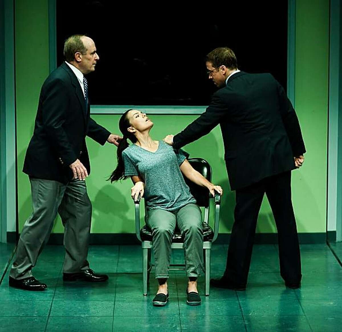 Mary (Stephanie Gularte, center) is interrogated by Elizabeth's men (Jesse Caldwell, left, and Peter Ruocco) in Mark Jackson's modernized version of Schiller's