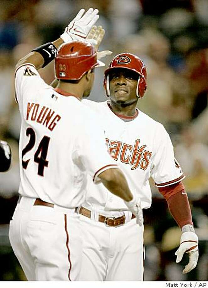 ** CORRECTS TO CHRIS YOUNG HIT A THREE-RUN HOME RUN,  NOT JUSTIN UPTON **Arizona Diamondbacks' Orlando Hudson, right, celebrates with teammate Chris Young after Young hit a three run home run against the Oakland Athletics during the first inning of a baseball game Wednesday, June 18, 2008 in Phoenix. (AP Photo/Matt York) Photo: Matt York, AP