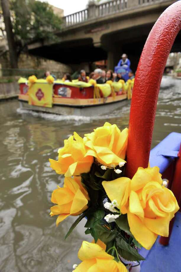 SLUG: Yellow Roses-Photo Request 56447-Feb 10, 2012-San Antonio, Texas---Yellow Roses adorn tourism barges along the the Riverwalk in a program spearheaded by The San Antonio Convention and Visitors Bureau has called the City of Yellow Roses that encourages hotels and restauants to give out yellow roses and offer specials to attract Valentine's Day visitors. Photo: Robin Jerstad, Photographs By Robin Jerstad/For The Express-News