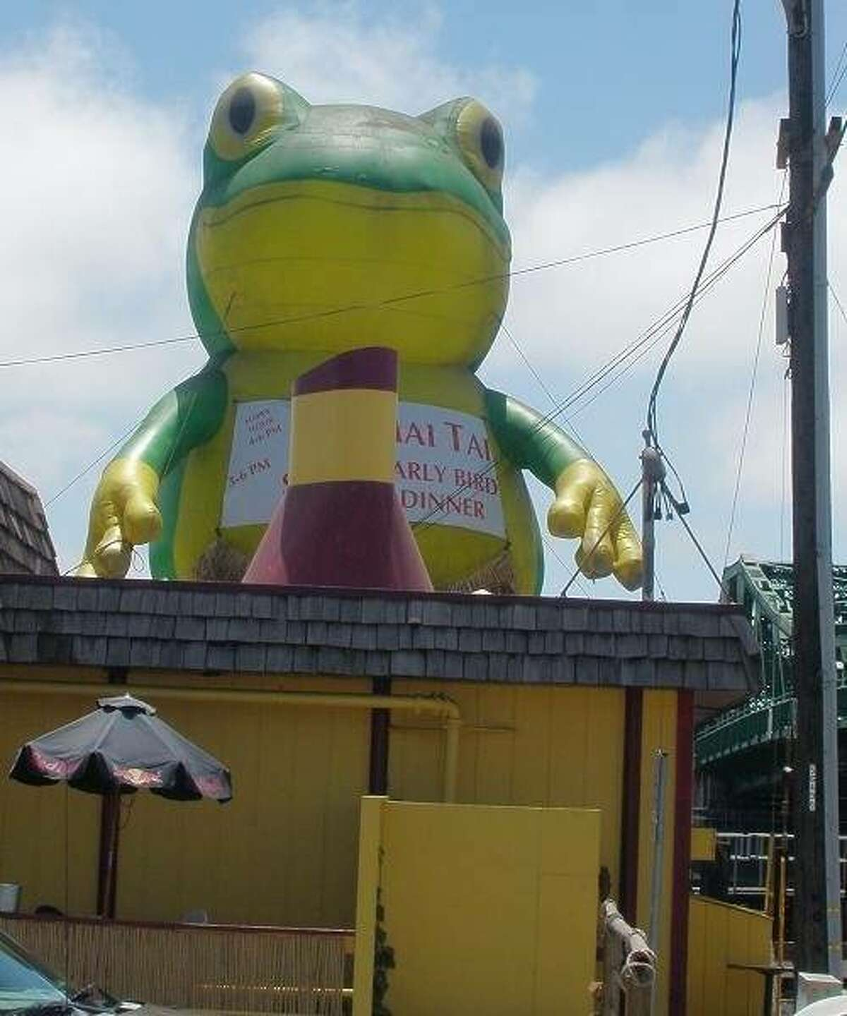 There's a giant inflatable frog outside of Tiki Tom's.