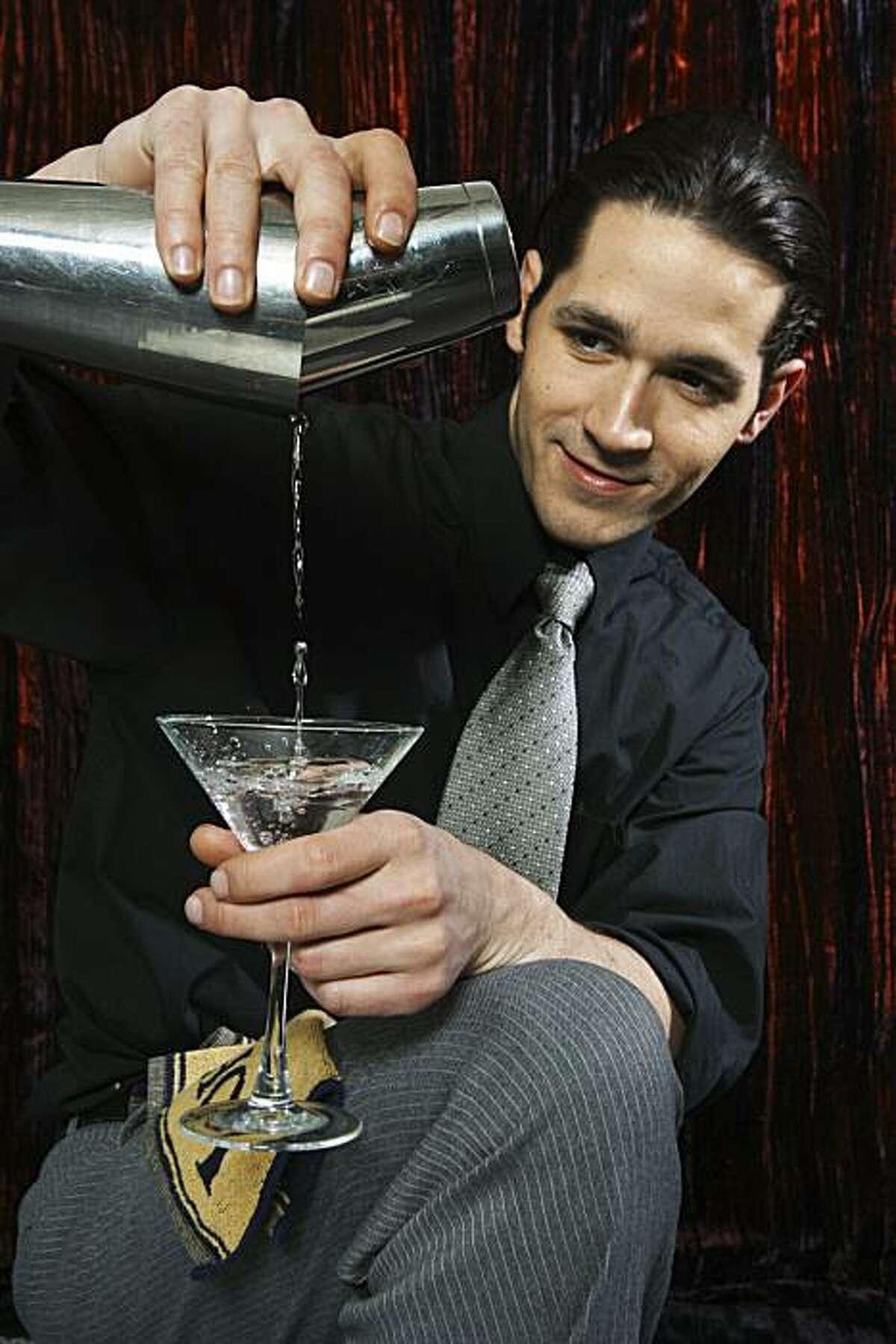 Bartender at work making a martini