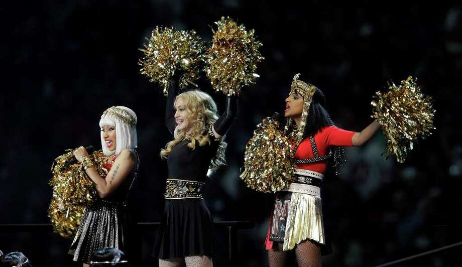 FILE - In this Feb. 5, 2012 file photo, Madonna, center, performs with Nicki Minaj, left, and M.I.A. during halftime of the NFL Super Bowl XLVI football game between the New England Patriots and the New York Giants in Indianapolis. Madonna says she's not happy that M.I.A. made an obscene gesture during the Super Bowl halftime show. Madonna said on Ryan Seacrest's radio show Friday, Feb. 10, that the gesture was pointless and ?seemed out of place.? The British hip-hop artist, invited by Madonna to participate in Sunday's halftime show in front of 114 million people, extended her middle finger to the camera. (AP Photo/Michael Conroy, file) Photo: Michael Conroy / Copyright 2012 The Associated Press. All rights reserved. This material may not be published, broadcast, rewritten or redistribu