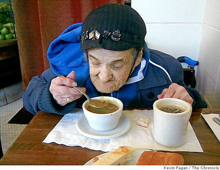 Millie, the North Beach street character, eats inside Cafe Divine at Union and Stockton Streets in San Francisco, Calif., on Feb. 19, 2009. Millie was back in the city chatting with customers and shooting Polaroid pictures for $5 a shot. Photo: Kevin Fagan, The Chronicle