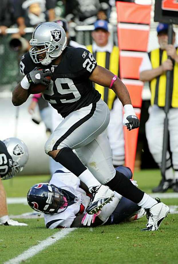 OAKLAND, CA - OCTOBER 3:  Running back Michael Bush #29 of the Oakland Raiders carries the ball against the Houston Texans  during an NFL football game October 3, 2010 at The Oakland-Alameda County Coliseum in Oakland, California. The Texans won the game31-24. Photo: Thearon W. Henderson, Getty Images