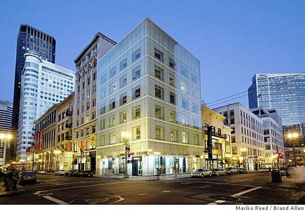 At 185 Post St. near Union Square, a 1908 structure now is encased by glass walls on Post St and Grant Avenue, giving it the look of an artifact in a display case. Photo: Mariko Reed, Brand Allen
