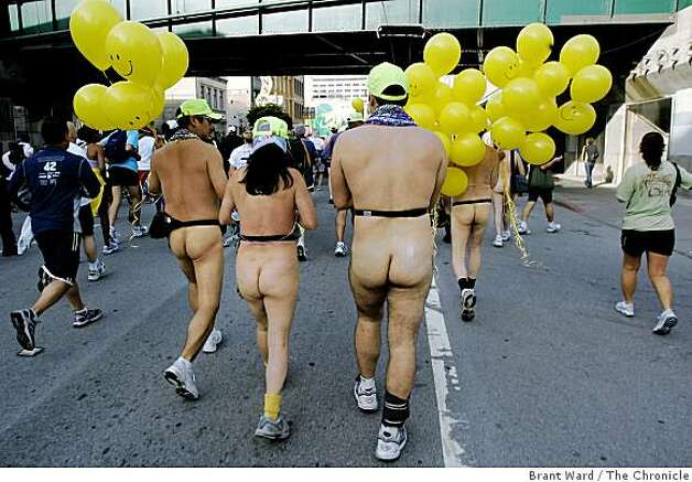What race would be complete without the naked runners and walkers...most walked including this group with yellow balloons. The 96th annual Bay to Breakers foot race took over the streets of San Francisco Sunday morning as thousands ran from Howard and Beale Streets to Ocean Beach. {Brant Ward/San Francisco Chronicle}5/20/07 Photo: Brant Ward, The Chronicle