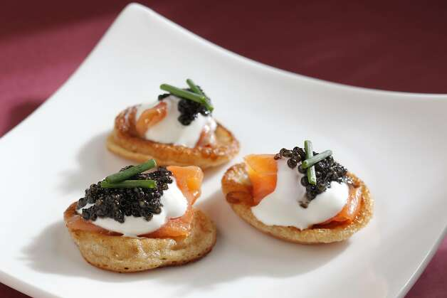 Buckwheat Blini with Smoked Salmon, Creme Fraiche & Cavier (Gary Danko) as seen in San Francisco, California on Wednesday, January 18, 2012. Food styled by Sunny Liu. Photo: Craig Lee, Special To The Chronicle