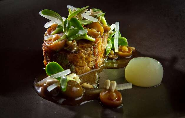 Beef braised with pear is served with tiny beech mushrooms, sunflower seeds and sprouts. Photo: John Storey, Special To The Chronicle