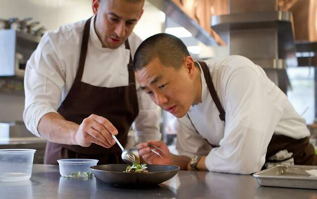 Chef Corey Lee, right, with sous chef Brandon Rodgers prepares Braised Beef at Benu restaurant in San Francisco, Calif., on Friday, February 3, 2012. Photo: John Storey