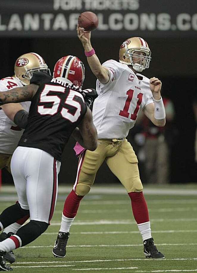 San Francisco 49ers quarterback Alex Smith (11) is pressured by Atlanta Falcons defender John Abraham (55) while looking for a receiver in the second half of a 16-14 loss to the Falcons in an NFL football game at the Georgia Dome in Atlanta, Sunday, Oct.3, 2010. Photo: Dave Martin, AP