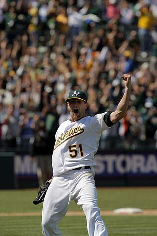 Dallas Braden reacts to pitching a perfect game as the last out is tallied against the Tampa Bay Rays in Oakland on Sunday. Photo: Carlos Avila Gonzalez, The Chronicle