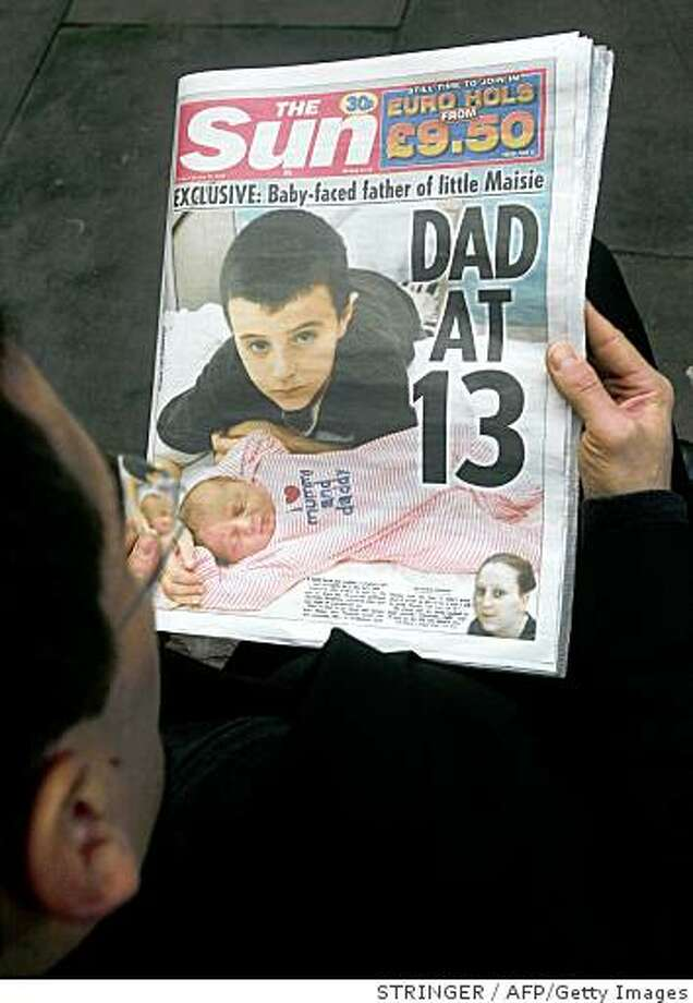 "A man reads a copy of the Sun newspaper in London, on February 13, 2009. A baby-faced 13-year-old British schoolboy has fathered a child with his 15-year-old girlfriend, making him one of the youngest parents ever in Britain, a report said Friday. Alfie Patten, whose voice has not yet broken, admitted he had not thought about how he and girlfriend Chantelle Steadman would support baby daughter Maisie Roxanne, as ""I don't really get pocket money."" AFP PHOTO/Stringer (Photo credit should read STRINGER/AFP/Getty Images) Photo: STRINGER, AFP/Getty Images"